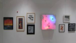 """An artistic gesture, conceived in the year 2013 for Madison Public Library's """"Q&A"""" exhibition, in which a red foam clown nose is attached to the gallery wall in an effort to consider the agency of the architecture itself"""