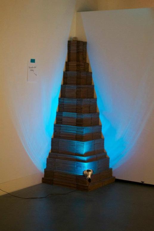 Deconstructed Iceberg mixed media (cardboard, blue light, rock, sign) 2012
