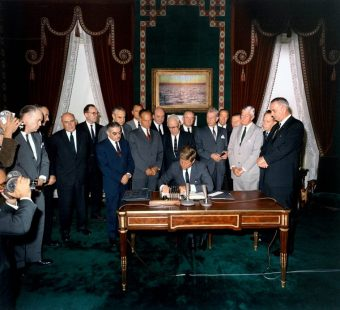 President Kennedy signs the Nuclear Test Ban Treaty in the White House Treaty Room - October 7, 1963, Digital Intervention